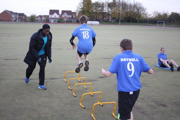 These pictures are of GB Sprinter Harry Aikines-Aryeetey visiting Belvoir High. Students are jumping over hurdles