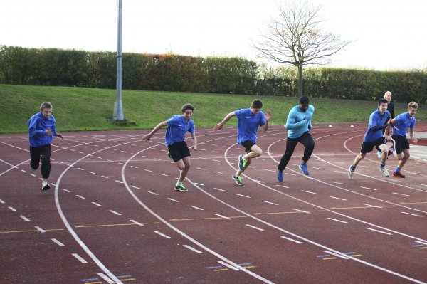 Students on the running track sprinting with Harry Aikines-Aryeetey