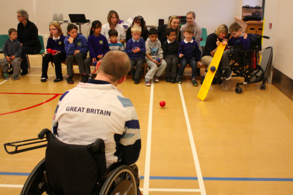 Dan demonstrating to the students at Birch wood how to play boccia