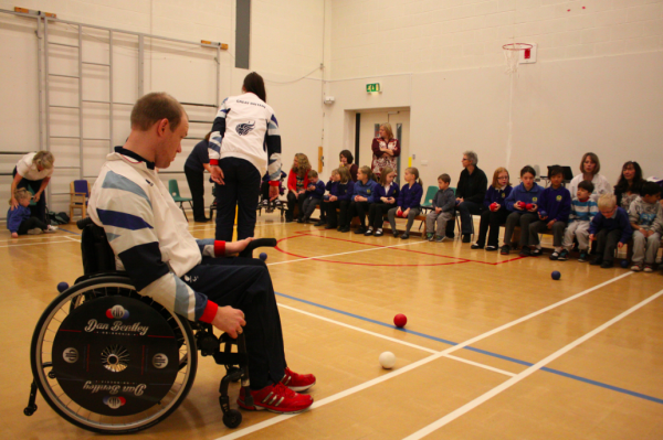 The students having a go at boccia with Daniel Bentley watching