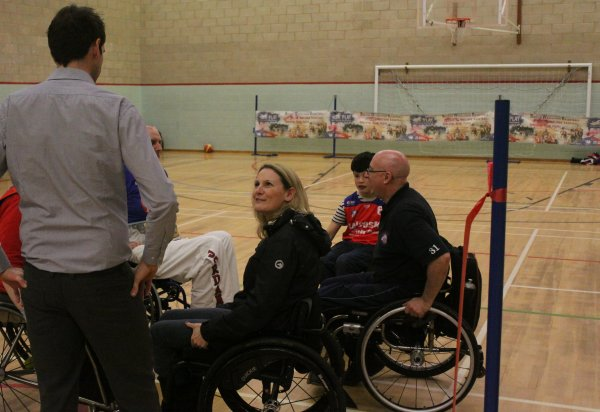 Pictures of the Melton Stallions wheelchair basketball launch event, People are in wheelchairs listening to the coach